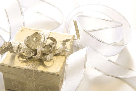 Christmas gift and ornament on silver background. Archivio Fotografico - 7542661