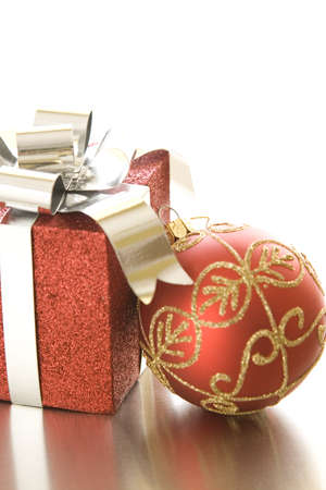 christmas gift: Christmas gift and ornament on silver background.