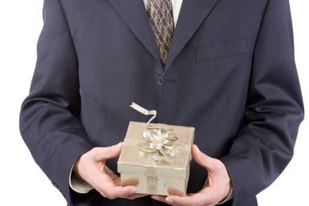 Happy businessman with a gift for holidays