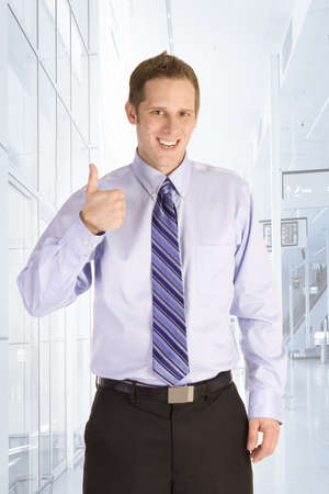 Young businessman using a call me gesture photo