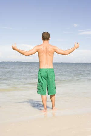 Attractive young man at the beach in green trunks Stock Photo - 7556681
