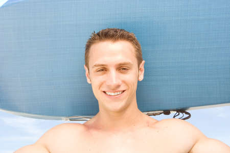 Attractive man at the beach with a body board. Stock Photo - 7556697