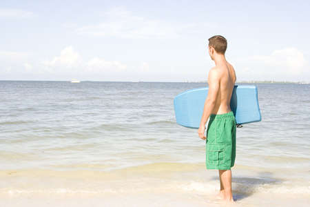 Attractive man at the beach with a body board. Stock Photo - 7556656
