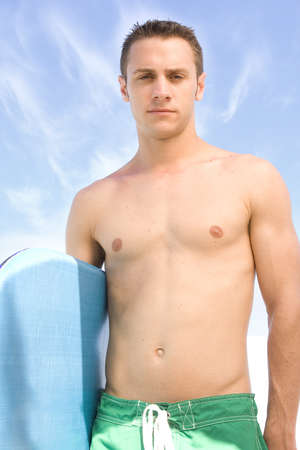 Attractive man at the beach with a body board. Stock Photo - 7556693