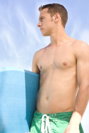 Attractive man at the beach with a body board. Stock Photo - 7556691