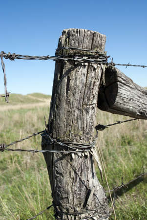 wire fence: Old Wooden Fence Post Stock Photo