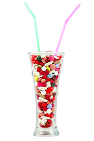 Tablets in a high glass a drinking straws  Colorful pills