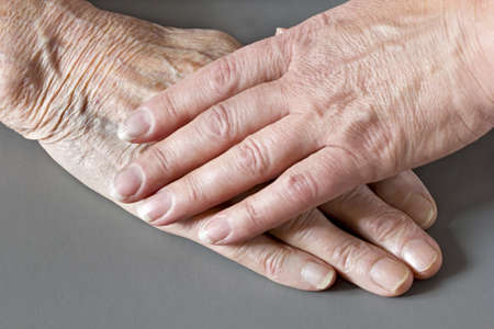 80 85: The elderly older and younger womans hands  Stock Photo