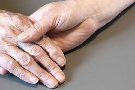 80 85: Older and younger womans hands
