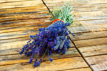Lavender bouquet on the old boards Stock Photo