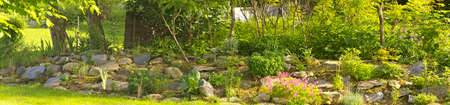 Composition of the garden on a slope Stock Photo