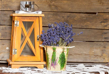 Lavender bouquet in the pail with lantern