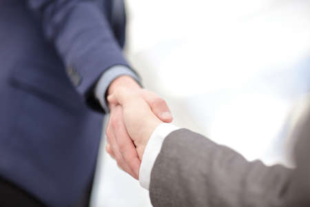 Close up view of business partnership handshake concept.Photo of two businessman handshaking process.Successful deal after great meeting. Standard-Bild