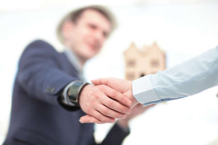 Close up view of business partnership handshake concept.Photo of two businessman handshaking process.Successful deal after great meeting. Stock Photo
