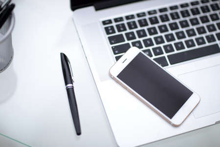 crystal background: laptop,notebook and phone, smartphone on the table.Office desk table.