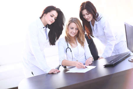 Portrait of three confident female doctors standing with arms crossed Stock Photo