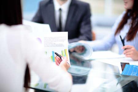 Business people Having Meeting Around Table In Modern Office Standard-Bild