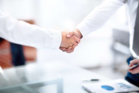 Two confident business man shaking hands during a meeting in office, success, dealing, greeting and partner concept. Standard-Bild