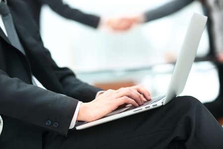 Handsome businessman working with laptop in office Standard-Bild