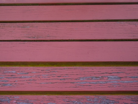 Red Plank Siding, Background.  Peeling paint, exposed wood photo