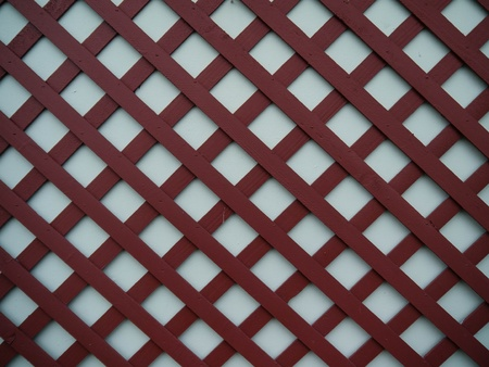 rasa: Brick red lattice background with grey color behind Stock Photo