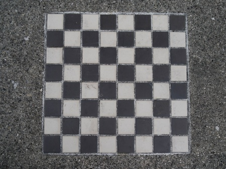 aggregate: Black and white outdoor checkerboard set in aggregate  frame