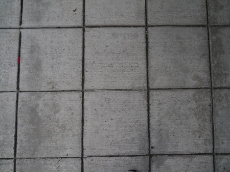 grout: Gray concrete squares background with black grout