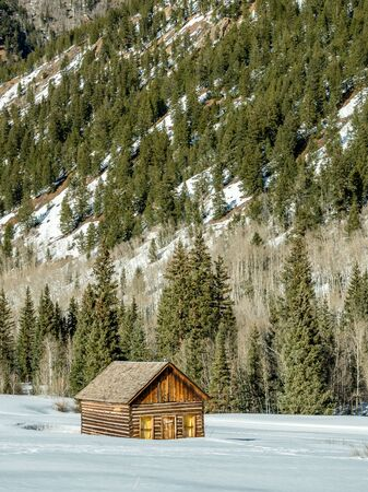 log cabin winter: Isolated log cabin in winter in the mountains Editorial