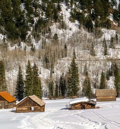 log cabin in snow: Four old, abandoned log buildings in Winter