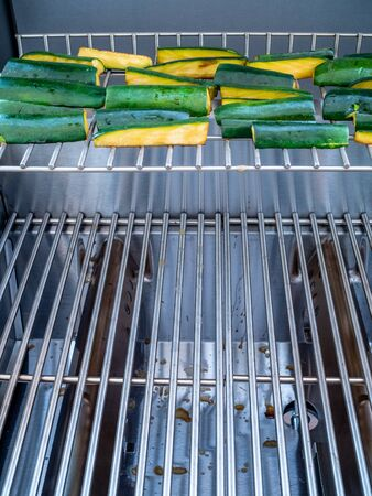 sizzle: Stainless steel grill cooking zucchini