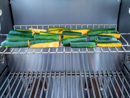 sizzle: Barbequeing zucchini on a stainless steel grill