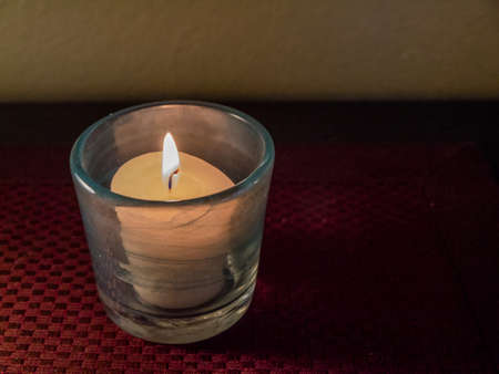 votive: Votive candle, round glass holder, red surface