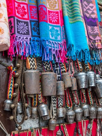 Yak bells and colorful scarves for sale in Nepal Stock Photo