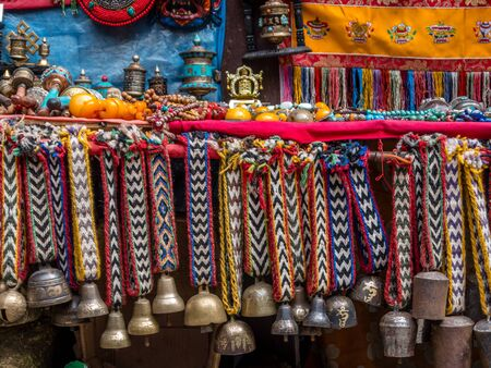 Yak bells on colorful knit ribbons, for sale