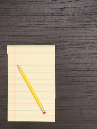 yellow notepad: Wood Desk, Yellow Notepad, Pencil