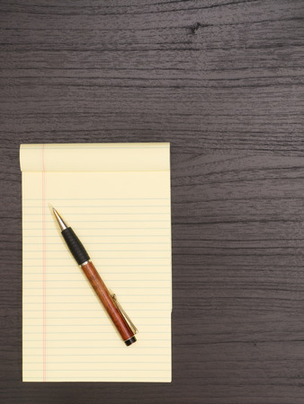 yellow notepad: Wood Desk, Yellow Notepad, Pencil on Desk