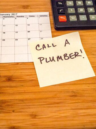 calendar, calculator, post it, plumbing Stock Photo