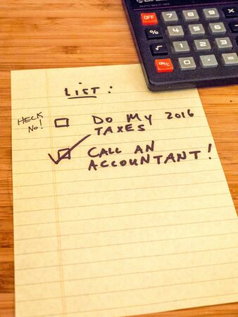 Call an accountant, don't do taxes yourself! Stock Photo