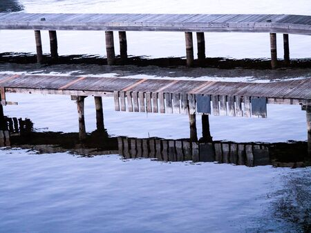 Wooden docks of old planks with reflections, landscape orientation Stock Photo