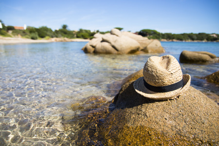 Hat on rock at beautiful beach