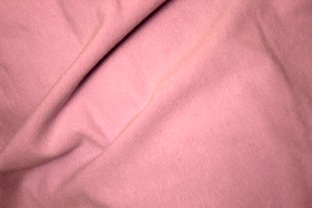 cotton fabric: This is a photograph of Light Pink cotton fabric background