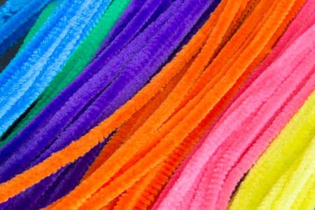 personal de limpieza: Esta es una fotografía de azul, verde, púrpura, naranja, rosa y amarillo de fondo limpiadores de pipa