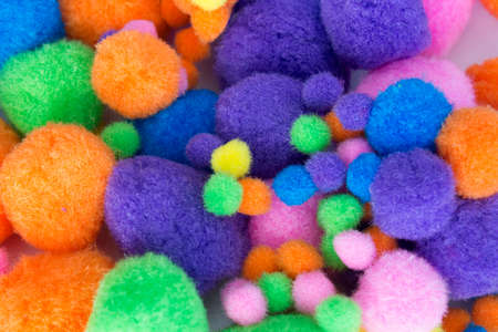 pom: This is a photograph of Fluffy colorful craft Pom Poms Stock Photo