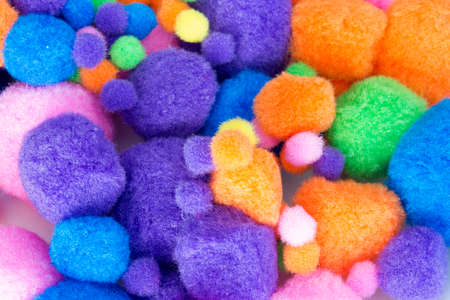 pom poms: This is a photograph of Fluffy colorful craft Pom Poms Stock Photo