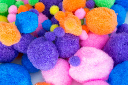 This is a photograph of Fluffy colorful craft Pom Poms Stock fotó