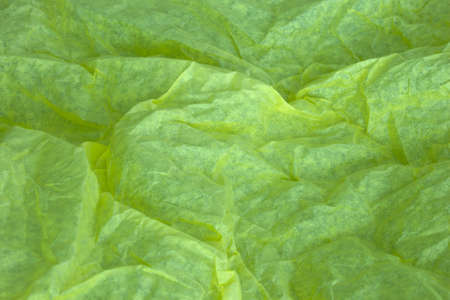 crinkly: This is a photograph of Yellow tissue paper background Stock Photo