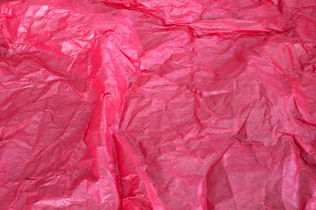 This is a photograph of Red tissue paper background