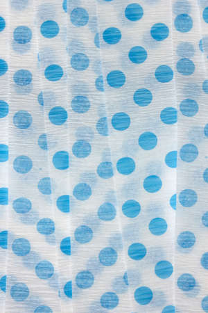 이것은 파란색 물방울 크레페 종이 깃발의 사진입니다.