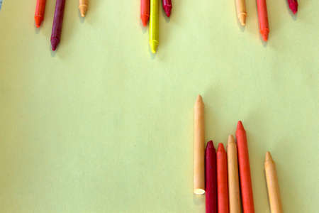 sharpened: This is a photograph of Red,Orange and Yellow crayons background