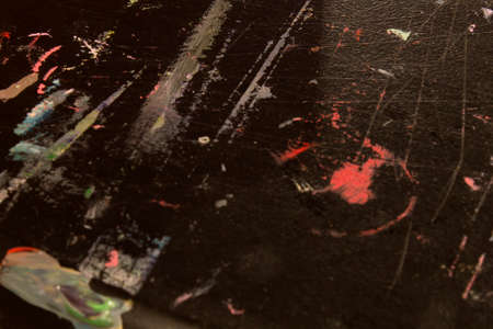 abstract paintings: This is a photograph of dried acrylic paint on a black table